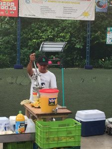 Uvita Costa Rica's farmers market orange juicer.
